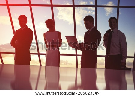 businesspeople in office against background of sky - stock photo