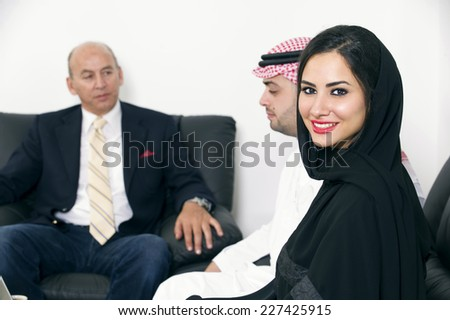 Businesspeople in office, Arabian Businesswoman wearing Hijab against colleagues meeting, Arabian Businesspeople meeting with foreigner  - stock photo