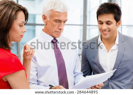 Businesspeople in office having discussion - stock photo