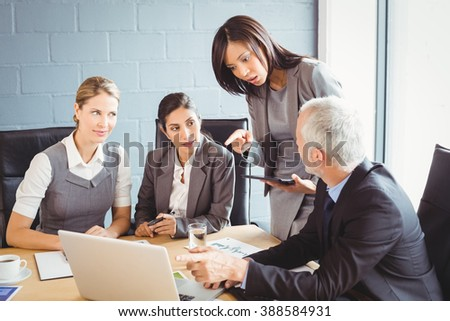 Businesspeople interacting at a meeting in conference room - stock photo