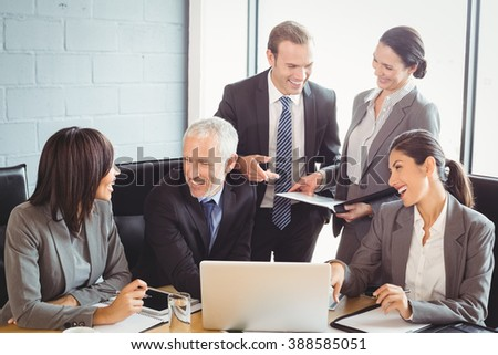 Businesspeople interacting at a meeting in conference room
