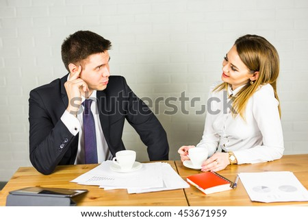 businesspeople interacting during coffee break at office - stock photo