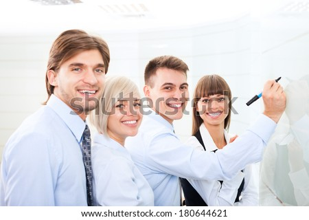 Businesspeople leader explaining draw marker, meeting in board room, businessman explaining colleagues group of business people team in office, conference