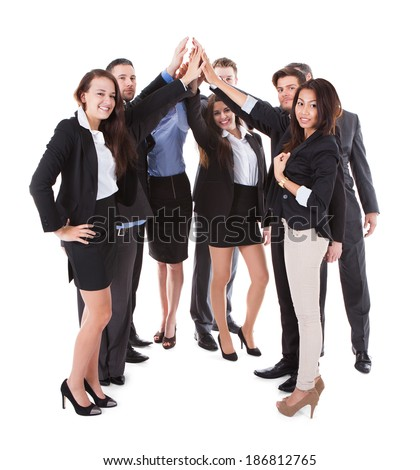 Businesspeople making high five gesture over white background - stock photo
