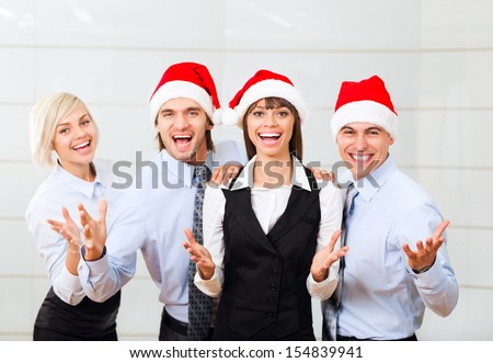 Businesspeople office party, celebrate new year christmas holiday, group of business people team wear santa hat, excited smile