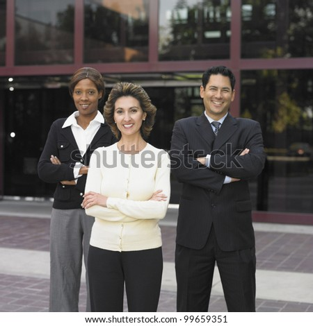 Businesspeople posing for the camera outdoors