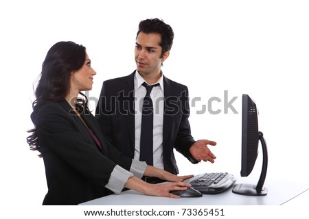 Businesspeople problem solving near a desktop computer - stock photo