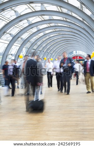 Businesspeople rushing in corridor, motion blur - stock photo