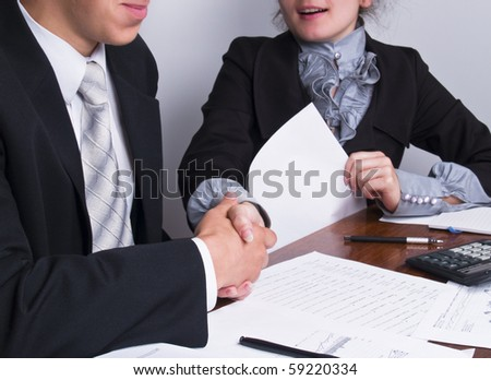 businesspeople shaking hands after agreement - stock photo