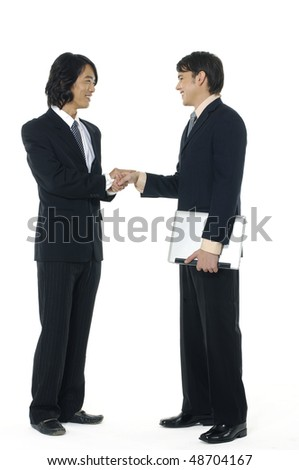 businesspeople shaking hands, finishing up a meeting - stock photo