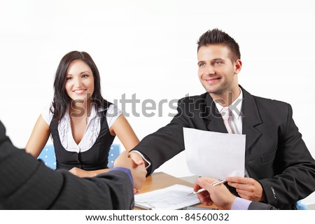 Businesspeople shaking hands in a meeting - stock photo