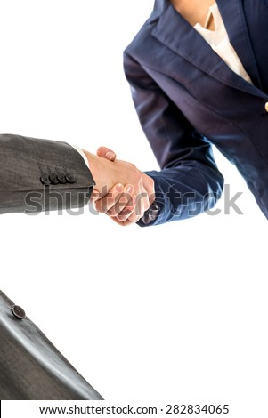 Businesspeople shaking hands to close a business deal, in partnership, teamwork or trust, isolated on white background. - stock photo