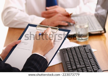 Businesspeople sitting at a table and signing a contract.isolated on white background