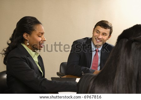 Businesspeople Sitting Conference Table Talking Smiling Stock Photo - 16 person conference table