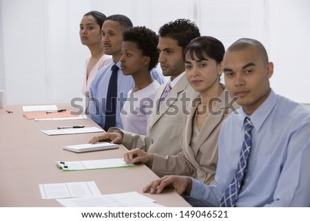 Businesspeople sitting at meeting