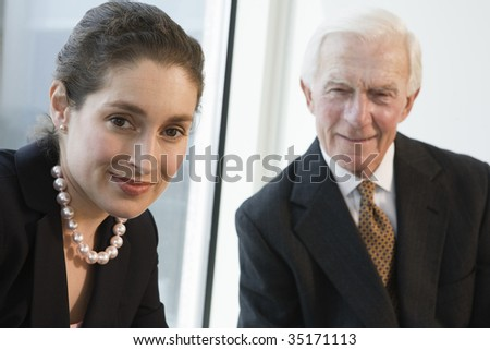 Businesspeople smiling - stock photo