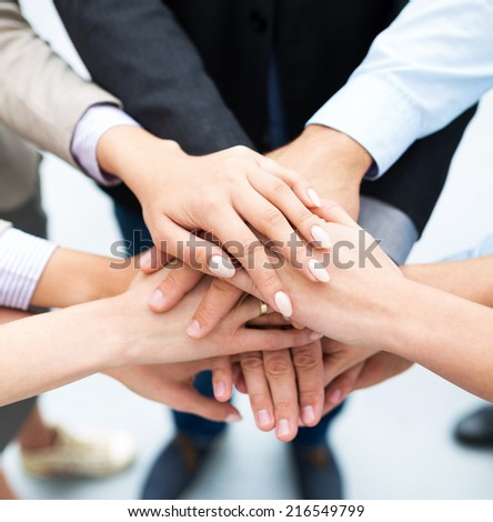 Businesspeople Stacking Hands - stock photo