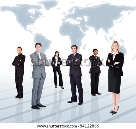 Businesspeople standing against a world map