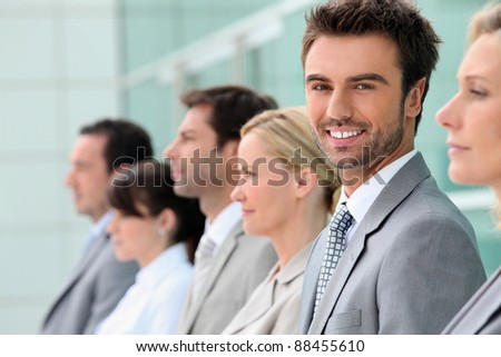 Businesspeople stood in a row - stock photo