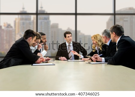 Businesspeople talking at the table. Collective's lively discussion at daytime. Every day should bring results. Step towards the common goal. - stock photo