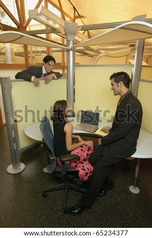 Businesspeople talking in office - stock photo