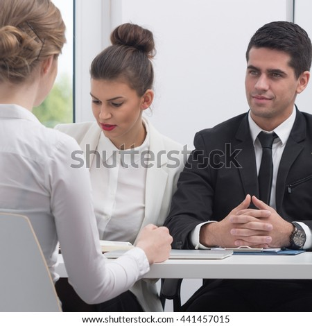 Businesspeople talking with customer in the office