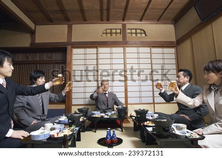 Businesspeople Toasting With Beer - stock photo