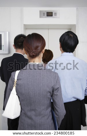 Businesspeople Waiting for Elevator