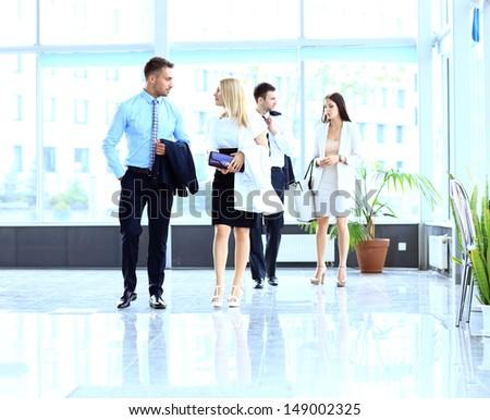 businesspeople walking in the corrido - stock photo