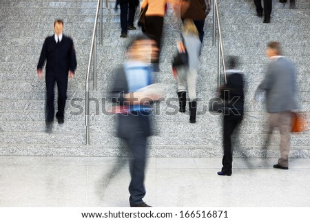 Businesspeople Walking Up Stairs, Motion Blur - stock photo