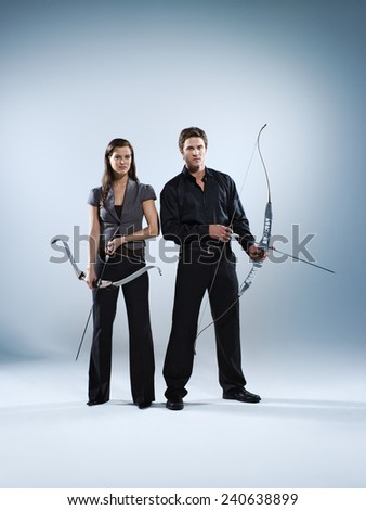 Businesspeople with Bow and Arrow - stock photo