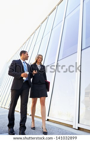 Businesspeople With Takeaway Coffee Outside Office - stock photo