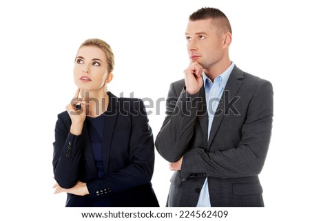 Businesspeople wondering about their corporation - stock photo