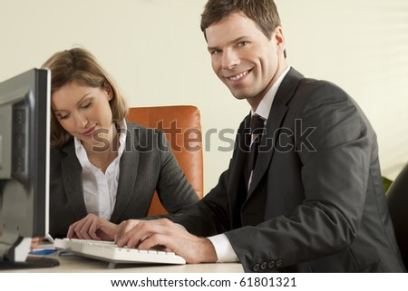 Businesspeople working in the office - stock photo