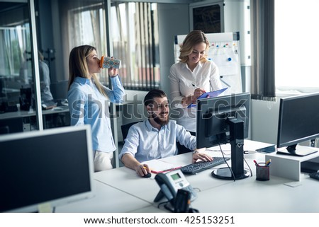 Businesspeople working together in an office. - stock photo