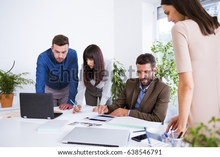Businesspeople working together in office.