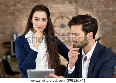 Businesspeople working with tablet, thinking. - stock photo