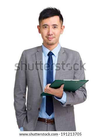 Businessperson holding clipboard - stock photo