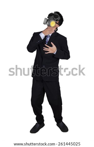 Businessperson wearing a gas mask and fail to breathe, isolated on white background - stock photo