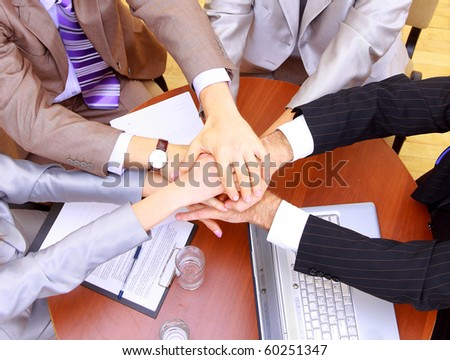 businessteam and hands on top of each other - stock photo