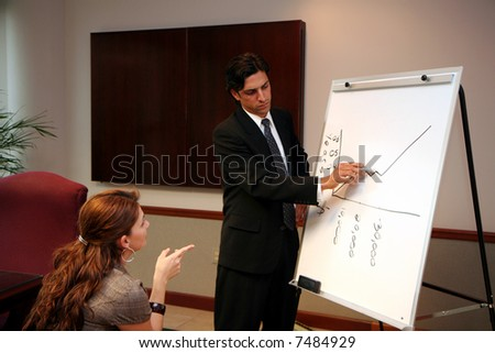 Businessteam dressed in formal business attire in an office - stock photo