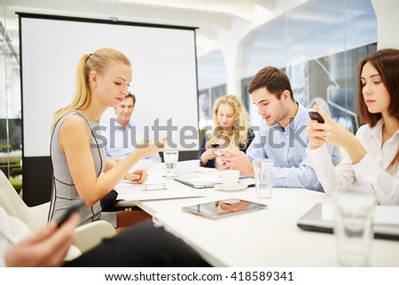 Businessteam of business people communicates with their smartphones - stock photo