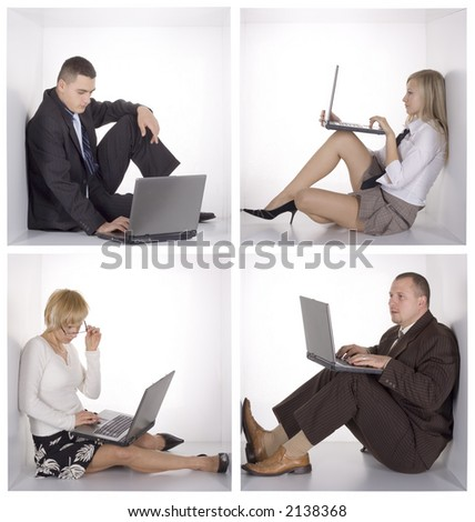 businessteam with laptops in the white cubes - stock photo