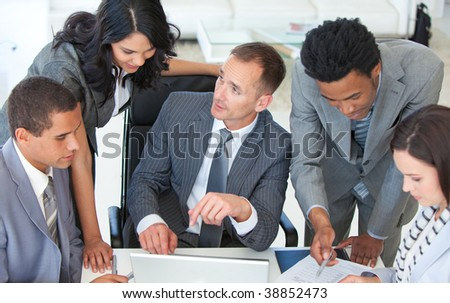 Businessteam working together in a business plan in office - stock photo