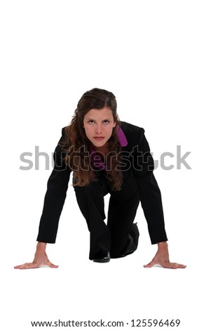 Businesswoman about to start foot race - stock photo