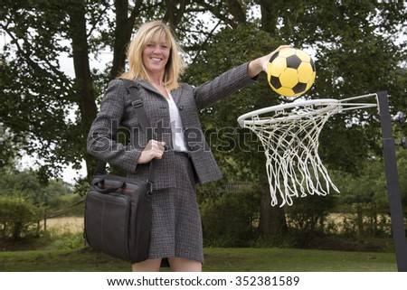 Businesswoman achieving her goal - stock photo