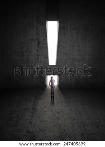 businesswoman against black wall with exclamation mark hole - stock photo