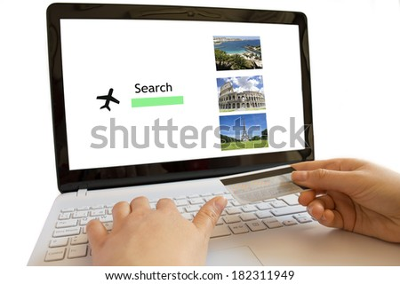 businesswoman airplane booking with  computer and credit card - stock photo