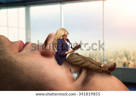 Businesswoman analyst is lying on the client's face