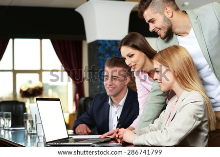 Businesswoman and business people working at notebook in conference room